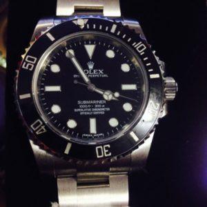 Гравировка логотипа на часах Rolex