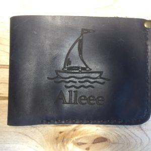 Гравировка логотипа на портмоне